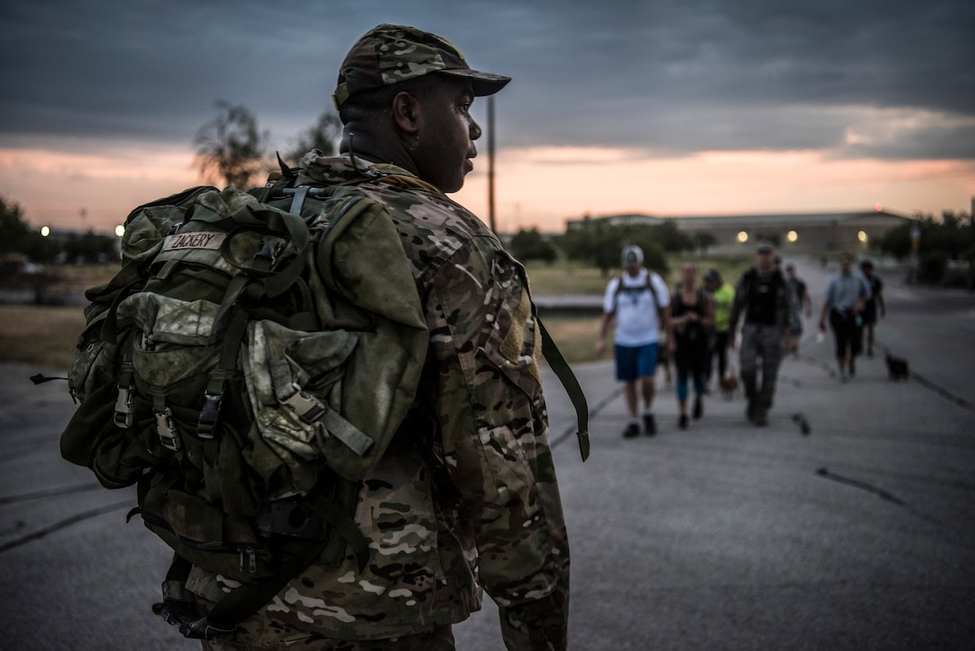 "47th Flying Training Wing Command Chief Master Sgt. Robert Zackery III, waits for Airmen at the finish line during the ""Walk with the Chief"" ruck march on Laughlin Air Force Base, Texas. July 23, 2019. ""Walk with the Chief"" is a monthly opportunity to interact with Laughlin's command chief, Chief Master Sgt. Robert Zackery III, in a fun and informal setting, and prepare Airmen for a deployed environment. (U.S. Air Force photo by Airman 1st Class Marco A. Gomez)"