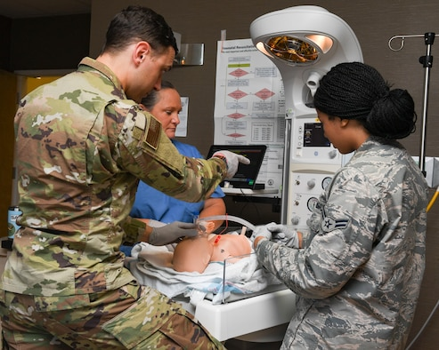 U.S. Air Force Capt. Trey Williams, MD, 633rd Medical Group pediatrician shows Airman 1st Class Monique Wood, 633rd MDG medical technician and Seffron Boyle, RN, 633rd NICU, the functions on an incubator, July 10, 2019, at Joint Base Langley-Eustis, Virginia.