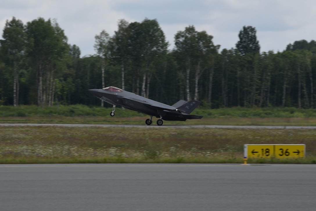 A U.S. Air Force F-35A Lightning II fighter jet deployed from the 388th and 419th Fighter Wings, Hill Air Force Base, Utah, lands on a runway during Operation Rapid Forge at Lielvarde Air Base, Latvia, July, 23, 2019. This is the first time a U.S. Air Force F-35 Lightning II stealth fighter has landed in Latvia. Operation Rapid Forge is intended to enhance interoperability with NATO allies to improve combined operational capabilities.