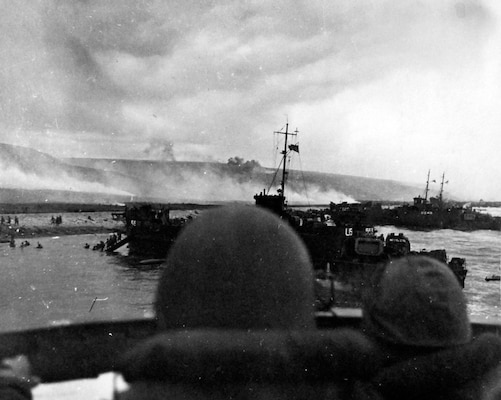 USS LCI(L)-553 and USS LCI(L)-410 land troops on Omaha Beach during initial assault on D-Day, June 6, 1944 (National Museum of the U.S. Navy/Naval History and Heritage Command)
