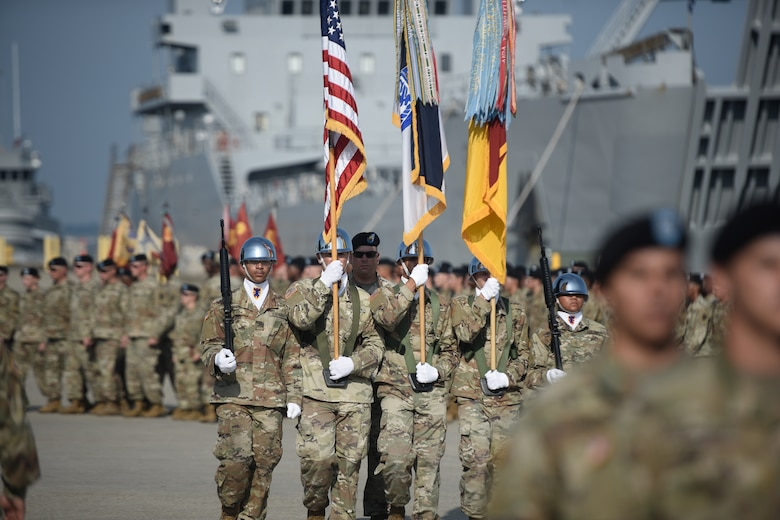 U.S. Army Color Guard Soldiers march with the colors during a 7th Transportation Brigade (Expeditionary) change of command ceremony at Joint Base Langley-Eustis, Virginia, July 18, 2019.