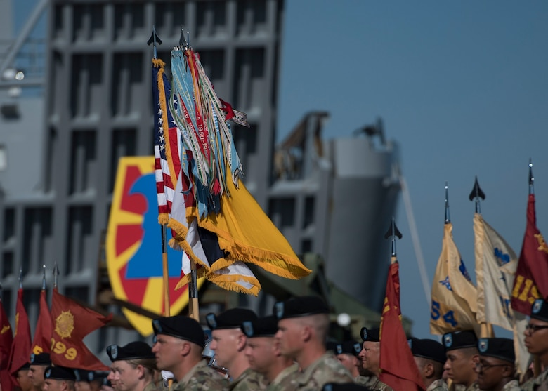 U.S. Army Soldiers assigned to the 7th Transportation Brigade (Expeditionary) raise the colors during a change of command ceremony at Joint Base Langley-Eustis, Virginia, July 18, 2019.