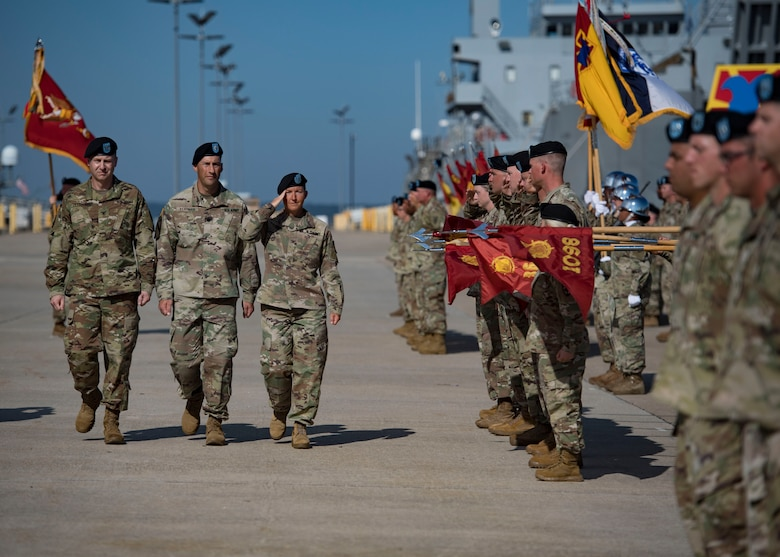 U.S. Army Col. Beth A. Behn, right, outgoing 7th Transportation Brigade (Expeditionary) commander, walks with Col. Timothy Zetterwall, left, incoming 7th TBX commander, and Lt. Col. Brian J. Slotnick, center, the ceremony's commander of troops, and salutes Soldiers in formation during a change of command ceremony at Joint Base Langley-Eustis, Virginia, July 18, 2019.