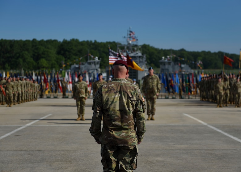 U.S. Army Maj. Gen. Brian J. McKiernan, XVIII Airborne Corps and Fort Bragg deputy commanding general, stands at attention before Soldiers during a 7th Transportation Brigade (Expeditionary) change of command ceremony at Joint Base Langley-Eustis, Virginia, July 18, 2019.