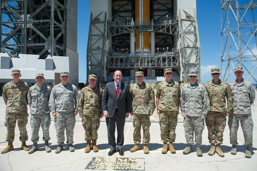 Acting Secretary of the Air Force Matthew Donovan poses for a photo in front of United Launch Alliance's Delta IV rocket with Brig. Gen. Doug Schiess, 45th Space Wing commander, and Airmen from the 45th Operations Group on July 19, 2019, at Space Launch Complex-37 on Cape Canaveral Air Force Station, Fla. Donovan visited the 45th Space Wing to become more familiar with space launch operations and celebrate the 50th anniversary of NASA's Apollo 11 mission. (U.S. Air Force photo by Jared Trimarchi)