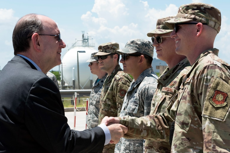 Acting Secretary of the Air Force Matthew Donovan shakes hands with a 45th Operations Group Airman on July 19, 2019, at Cape Canaveral Air Force Station, Fla. Donovan met with 45th OG Airmen to become more familiarized with the 45th Space Wing's mission of providing space launch capabilities to the Nation and the warfighter. (U.S. Air Force photo by Airman 1st Class Zoe Thacker)