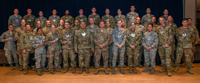 PETERSON AIR FORCE BASE, Colo. – Airmen from Team Pete who were recently selected for promotion to technical sergeant pose for a group photo during a release party July 19, 2019 on Peterson Air Force Base, Colorado. 9,467 staff sergeants were selected for promotion across the Air Force for a selection rate of 32.28%. (U.S. Air Force photo by Craig Denton)