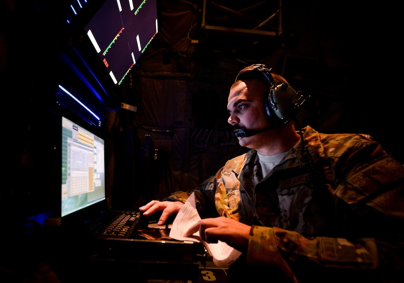 EC-130J Commando Solo systems operator monitors broadcast during mission in support of Operation Inherent Resolve at undisclosed location in Southwest Asia, September 5, 2017 (U.S. Air Force/Michael Battles)