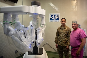 U.S. Air Force Lt. Col. Josh Tyler, 81st Surgical Operations Squadron Institute for Defense Robotic Surgery Education director, and Maj. Scott Thallemer, 81st MSGS InDORSE robot coordinator, pose for a photo in the Clinical Research Lab on Keesler Air Force Base, Mississippi, June 27, 2019. InDORSE is a program created by Tyler and Thallemer to provide surgeons with training on the DaVinci Xi surgical robot. Keesler AFB was the first hospital to have the DaVinci Xi in the Air Force. (U.S. Air Force photo by Airman 1st Class Kimberly L. Mueller)