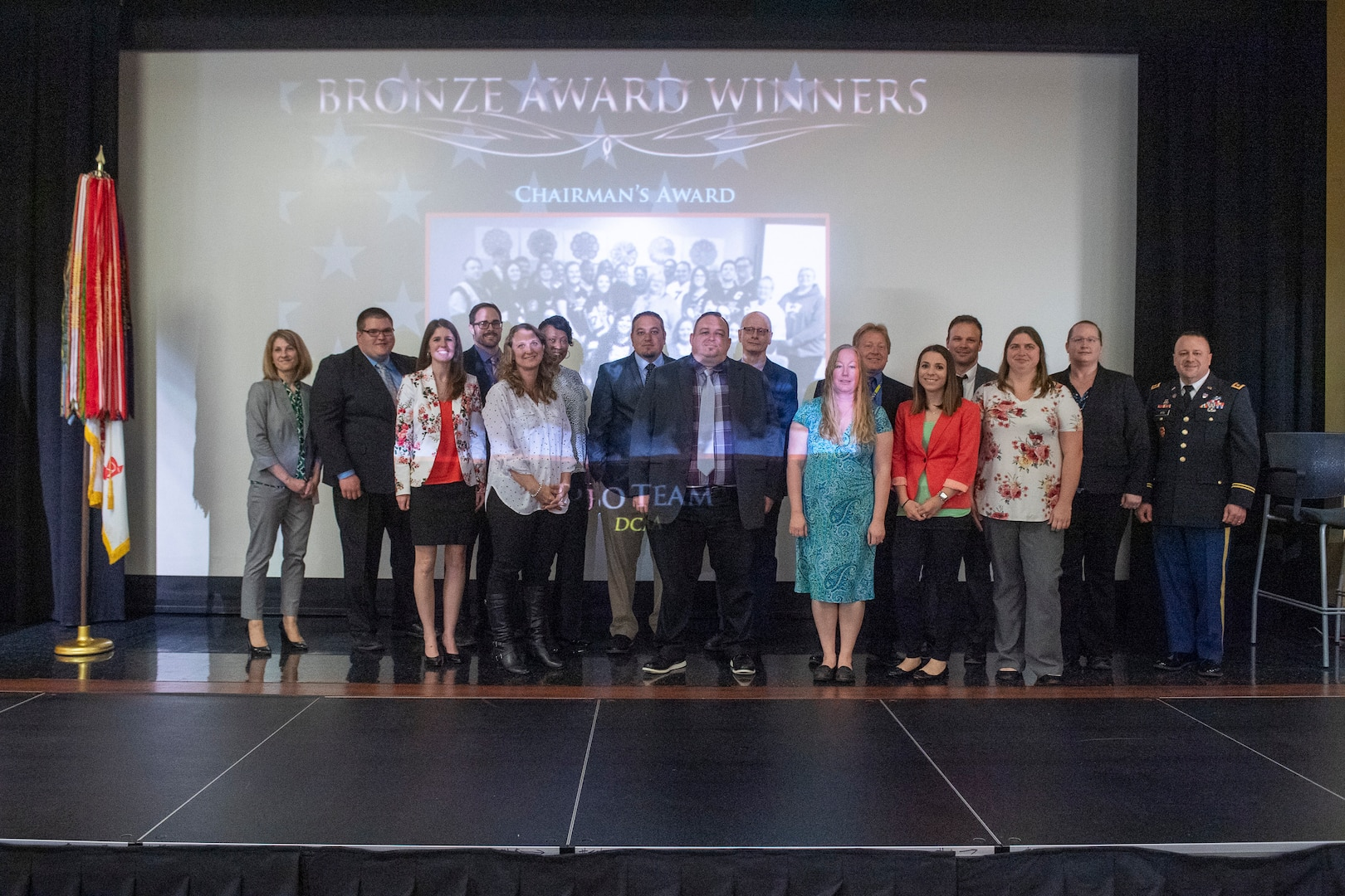 group of people in standing for award ceremony