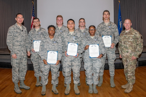 Col. Patrick Carley, 42nd Air Base Wing commander and Chief Master Sgt. Michael Morgan, 42nd ABW command chief, stand on either side of Airman Joshua Bills, Senior Airman Forrest Bivens, Airman 1st Class Brandon Hedelund, Airman 1st Class Christopher James, Airman 1st Class Deja Freeney, Airman 1st Class Kobi Hsu, Airman 1st Class Keivona Morgan, Maxwell Honor Guardsmen, for a group photo after presenting them Air Force Achievement Medals, July 18, 2019, Maxwell Air Force Base, Alabama. The group of Maxwell Honor guardsmen were bestowed the medals for assisting a local woman when her garage suddenly caught fire. (U.S. Air Force photo by Cassandra Cornwall)