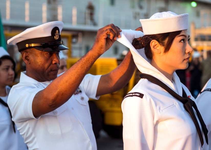 Senior Chief Aviation Support Equipment Technician Augustine Ilomuanya, assigned to amphibious assault ship USS Makin Island, conducts dress white uniform inspection, San Diego, March 22, 2019 (U.S. Navy/Colby A. Mothershead)