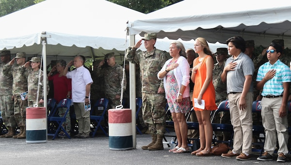 Lt. Gen. Laura J. Richardson, U.S. Army North Commanding General, Maj. Gen. David P. Glaser, the new U.S. Army North Deputy Commanding General-Operations and guests stand and honor the nation's colors during the National Anthem during a ceremony at the Quadrangle at Joint Base San Antonio-Fort Sam Houston July 23.
