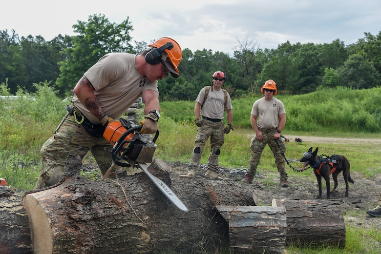 Master Sgt. Rudy Parsons, a pararescueman with the Kentucky Air National Guard's 123rd Special Tactics Squadron, and Callie, his search and rescue dog, participate in Patriot North, an annual domestic operations exercise designed to provide natural disaster-response training at Volk Field, Wis., July 15, 2019. Callie is currently the only search and rescue dog in the Department of Defense. (U.S. Air National Guard photo by Staff Sgt. Joshua Horton