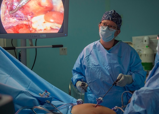 A doctor performs a surgery.