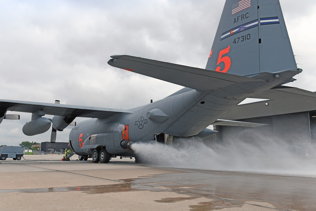 A 302nd Airlift Wing Modular Airborne Fire Fighting System equipped-C-130 Hercules aircraft performs a system test at Peterson Air Force Base, Colorado, July 22, 2019