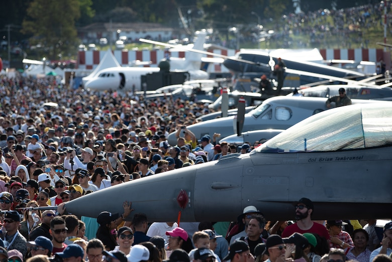 Visitors gather to watch an aerial demonstration during the Feria Aeronáutica Internacional—Colombia 2019 (F-AIR) at José María Córdova International Airport in Rionegro, Colombia, July 14, 2019.