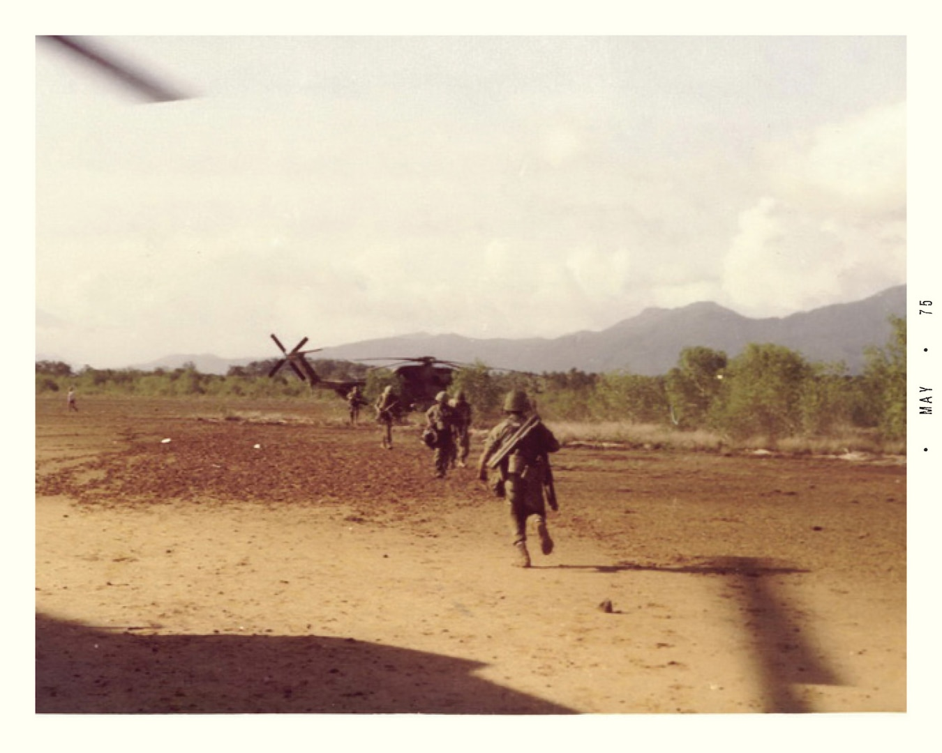 """CH-53 """"Jolly Green"""" helicopter on Cambodia mainland during rescue operation (Jim Davis/Gerald R. Ford Presidential Library)"""