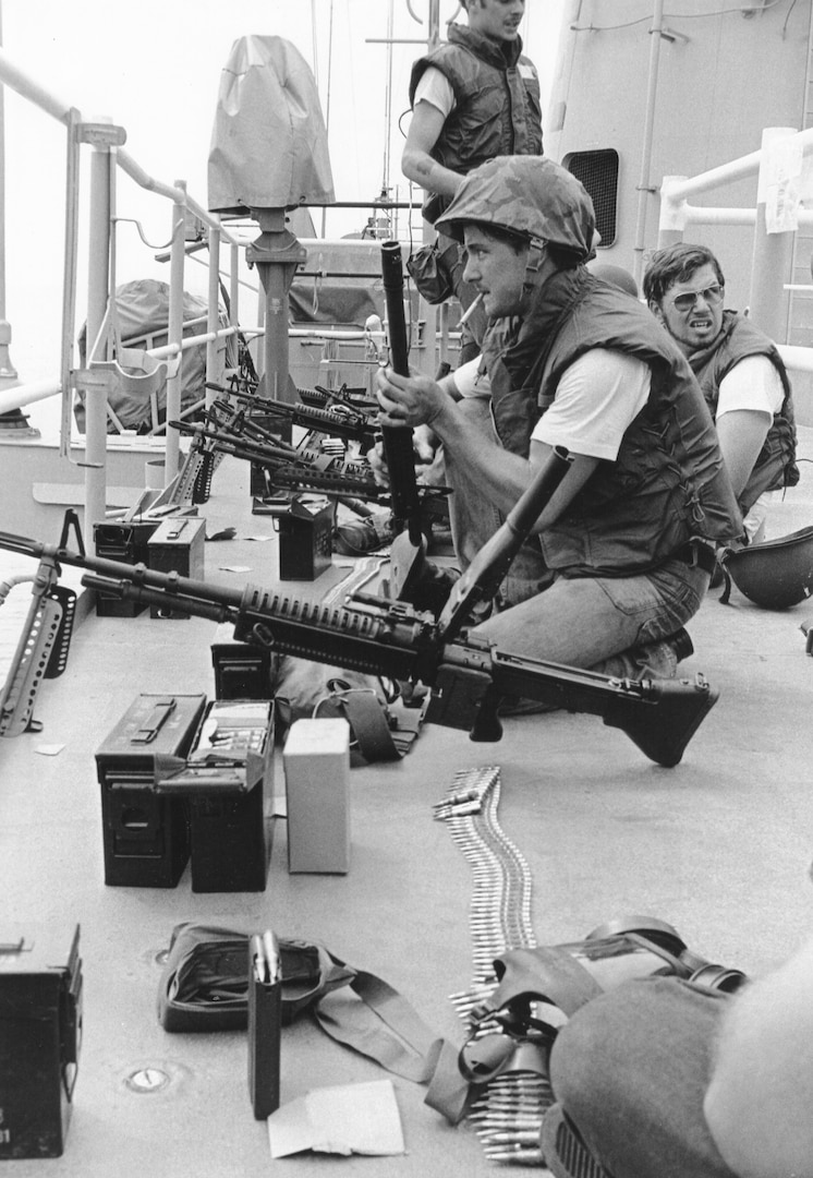 Marines with M-60 machine guns on deck of merchant ship SS Mayaguez after boarding it and finding it empty (U.S. Marine Corps)