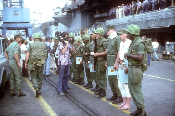 Marines from Company G and Company E, 2nd Battalion, 9th Marines, being interviewed pier side following rescue operation of merchant vessel SS Mayaguez, May 20, 1975 (Gerald R. Ford Presidential Library)