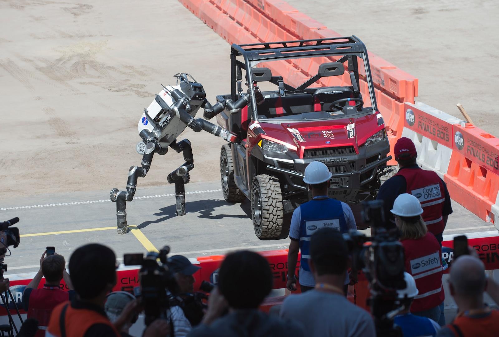 RoboSimian from Jet Propulsion Laboratory exits vehicle during DARPA Robotics Challenge, June 5, 2015, in Pomona, California (U.S. Navy/John F. Williams)