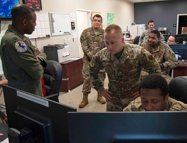 U.S. Airmen assigned to the 20th Operations Support Squadron weather flight office work together to monitor local weather at Shaw Air Force Base, South Carolina, June 21, 2019.