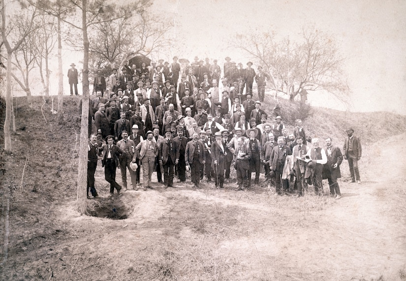 Civil War veterans of 57th Massachusetts Infantry Regiment pose with Confederate General William Mahone on May 3, 1887, at crater caused by Union Soldiers exploding mine at Petersburg, Virginia (Library of Congress/William H. Tipton)