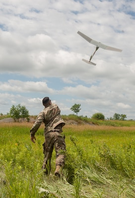 Cpl. Matthew Mena, field artillery tactical data system specialist assigned to Charlie Battery, 1st Battalion, 258th Field Artillery Regiment, launches a RQ-11B Raven small unmanned aircraft system during the unit's annual training at Fort Drum, N.Y., July 21, 2019. During the training, Soldiers across the 27th Infantry Brigade Combat Team were able to log flight time on the Raven to keep their operator certifications current.