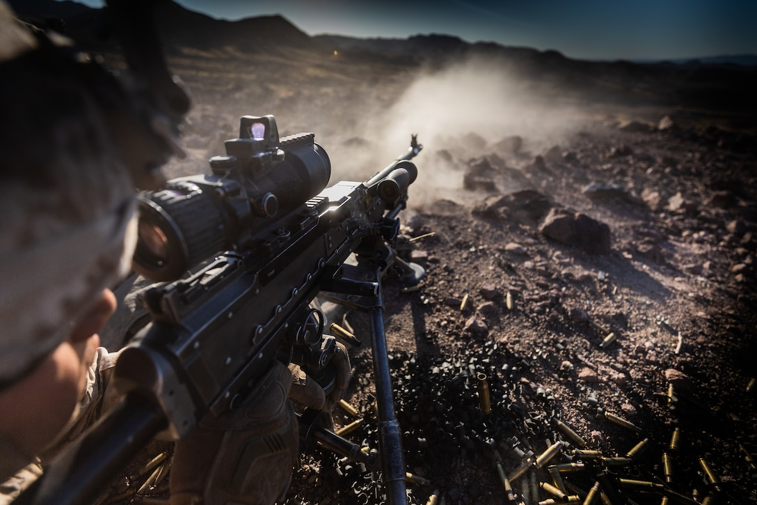 A U.S. Marine with Company I, 3rd Battalion, 7th Marine Regiment, 1st Marine Division, engages a target utilizing the M240G during a squad attack at Marine Corps Air Ground Combat Center, Twentynine Palms, Calif., July 15, 2019. The training was conducted to validate the squad leaders capabilities to lead and control their squads while integrating supporting arms in a deliberate attack.