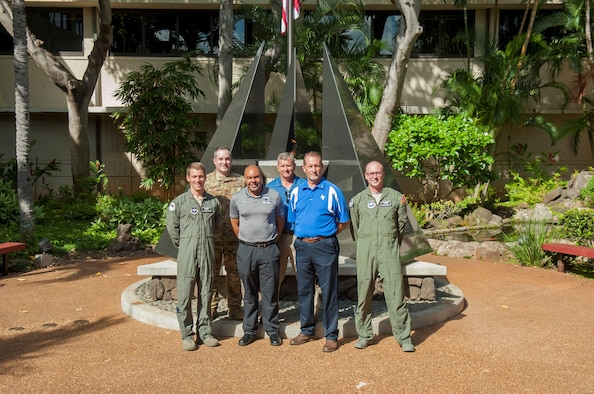Members of the 12th Operations Support Squadron and 559th Flying Training Squadron, at Joint Base San Antonio-Randolph, Texas, pose for a group photo during a history tour at Headquarters Pacific Air Forces, Joint Base Pearl Harbor-Hickam, Hawaii, July 10, 2019. The purpose of the visit was for Air Education and Training Command (AETC) members to learn more about Pacific theater operations and build and a relationship between AETC as a major command (MAJCOM) and PACAF as a combatant command (COCOM).