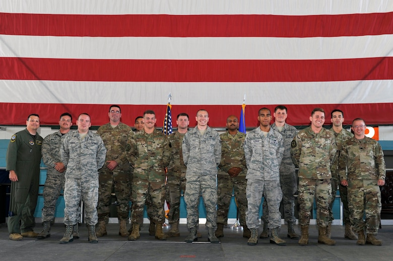 U.S. Air Force Lt. Col. Joey Sullivan, 415th Special Operation Squadron commander (left) and Lt. Col. Scott Ruppel, 58th Aircraft Maintenance Squadron commander (right), pose with dedicated and assistant dedicated crew chiefs from the 415th Aircraft Maintenance Unit during a ceremony at Kirtland Air Force Base, N.M., July 19, 2019. More than 20 members of the 415th and 71st AMUs were recognized during the ceremony. These dedicated and assistant dedicated crew chiefs will now have their names put on the aircraft assigned to them and are responsible for all maintenance done on that aircraft. (U.S. Air Force photo by Staff Sgt. Dylan Nuckolls)