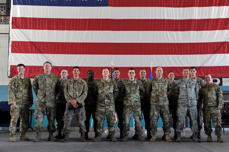 U.S. Air Force Lt. Col. Frederic Lathrop, 71st Special Operation Squadron director of operations (left) and Lt. Col. Lt. Col. Scott Ruppel, 58th Aircraft Maintenance Squadron commander (right), pose with dedicated and assistant dedicated crew chiefs from the 71st Aircraft Maintenance Unit during a ceremony at Kirtland Air Force Base, N.M., July 19, 2019. More than 20 members of the 415th and 71st AMUs were recognized during the ceremony. These dedicated and assistant dedicated crew chiefs will now have their names put on the aircraft assigned to them and are responsible for all maintenance done on that aircraft. (U.S. Air Force photo by Staff Sgt. Dylan Nuckolls)