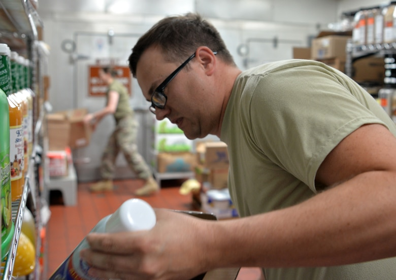 "Staff Sgt. Shane Thornton, a storeroom manager, assigned to 99th Force Support Squadron, restocks inventory during Red Flag 19-3 at Nellis Air Force Base, Nev, July 19, 2019. Red Flag is a combat training exercise designed to expose pilots to their first 10 ""combat missions"", allowing them to be more confident and effective in real-world combat. (U.S. Air Force photo by Tech. Sgt. Bryan Magee)"