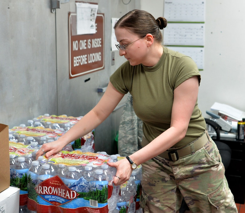 Staff Sgt. Jessica Sides, 99th Force Support Squadron storeroom clerk, restocks inventory during Red Flag 19-3 at Nellis Air Force Base, Nev., July 19, 2019. Red Flag is a combat training exercise involving the U.S. Air Force and its joint and coalition partners. (U.S. Air Force photo by Tech. Sgt. Bryan Magee)