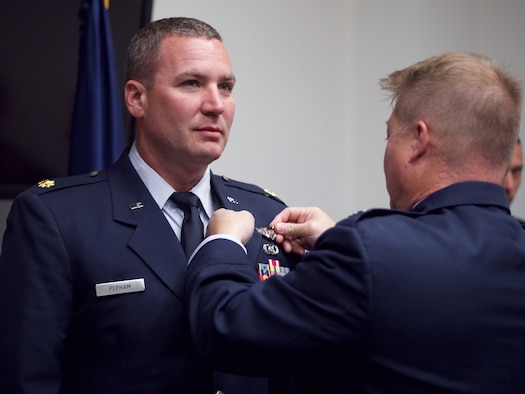 Alaska Air Guard officers pin on ABM wings