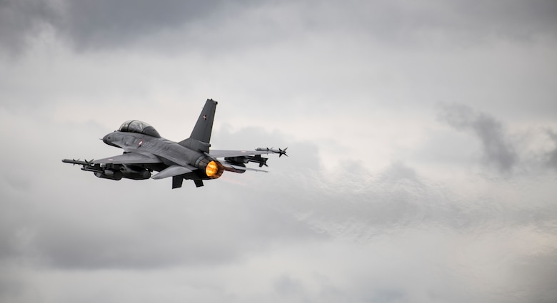 A Danish Air Force General Dynamics F-16AM/BM Fighting Falcon flies past the audience during the NATO 70th Anniversary Flypast at the 2019 Royal International Air Tattoo at RAF Fairford, England, July 20, 2019. This year, RIAT commemorated the 70th anniversary of NATO and highlighted the United States' enduring commitment to its European allies. (U.S. Air Force photo by Airman 1st Class Jennifer Zima)