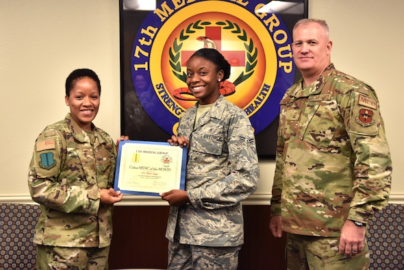 U.S. Air Force Col. Lauren Byrd, 17th Medical Group commander, presents Airman 1st Class Jessica Savage, 17th Medical Support Squadron referrals management clerk, with the Medic of the Month award at the Ross Clinic on Goodfellow Air Force Base, Texas, July 15, 2019. With help of Savage's efforts the referral center was rated number one in Air Education and Training Command. (U.S. Air Force photo by Senior Airman Seraiah Wolf/Released)