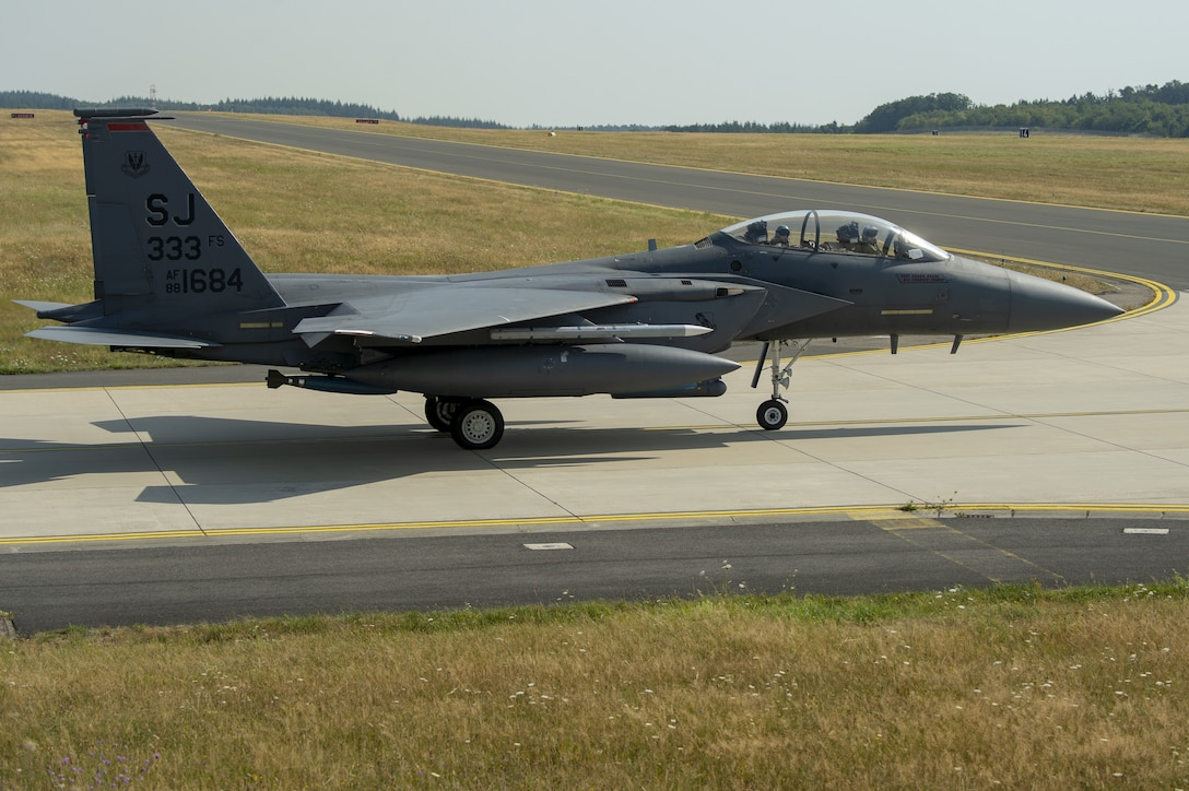 A U.S. Air Force F-15E Strike Eagle, assigned to the 4th Fighter Wing, Seymour Johnson Air Force Base, North Carolina, taxis on the flightline during Operation Rapid Forge at Spangdahlem Air Base, Germany, July 25, 2019. at Spangdahlem Air Base, Germany, July 25, 2019. The goal of the operation is to enhance readiness in coordination with U.S. allies and partners in Europe. (U.S. Air Force photo by Airman 1st Class Branden Rae)   (U.S. Air Force photo by Airman 1st Class Branden Rae)