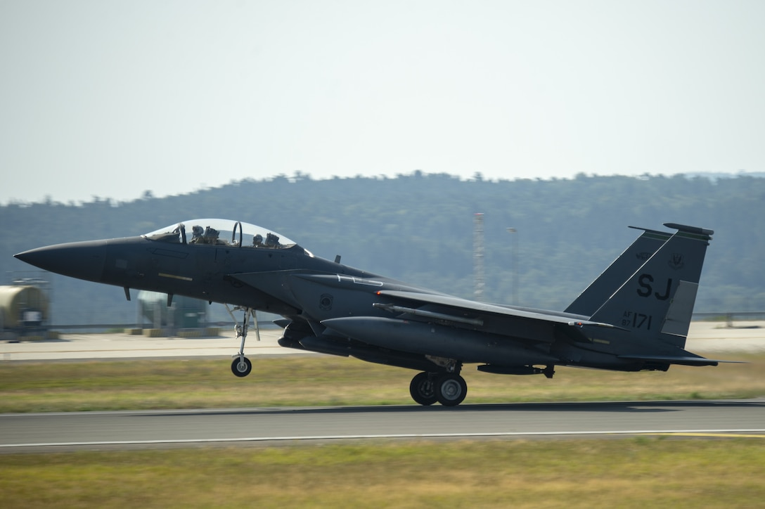 A U.S. Air Force F-15E Strike Eagle, assigned to the 4th Fighter Wing, Seymour Johnson Air Force Base, North Carolina, takes off the flightline during Operation Rapid Forge at Spangdahlem Air Base, Germany, July 25, 2019. Rapid Forge aircraft are forward deploying to bases in the territory of NATO allies in order to enhance readiness and improve interoperability. (U.S. Air Force photo by Airman 1st Class Branden Rae)