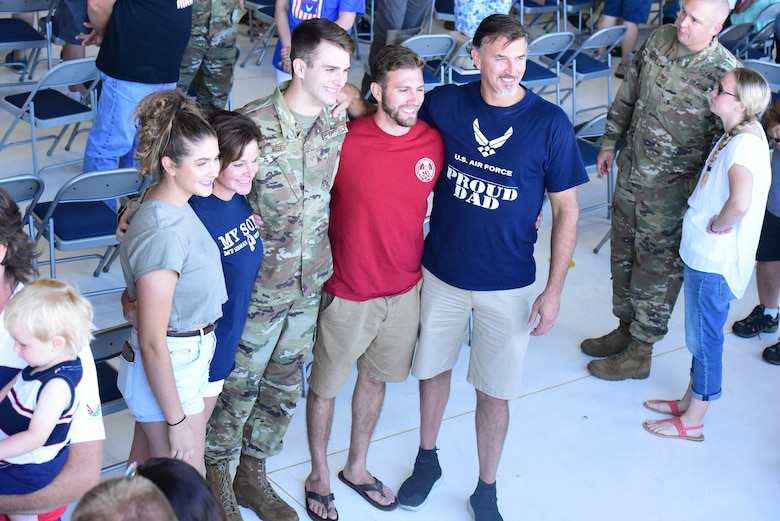 Senior Airman Nicholas Weber poses for a family photo at a send off ceremony held for deploying members of the 115th Figher Wing at Truax Field, Madison, Wis. on July 21, 2019.  The 115th Fighter Wing deployed approximately 300 personnel and a number of aircraft to Afghanistan in support of Operation Freedom Sentinel and NATO's Resolute Support. (U.S. Air National Guard photo by Staff Sgt. Kyle Russell)