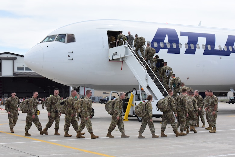 Airmen from the 115th Fighter Wing board a Boeing 767 aircraft after a send off ceremony held at Truax Field, Madison, Wis. on July 21, 2019.  The 115th Fighter Wing deployed approximately 300 personnel and a number of aircraft to Afghanistan in support of Operation Freedom Sentinel and NATO's Resolute Support. (U.S. Air National Guard photo by Staff Sgt. Kyle Russell)
