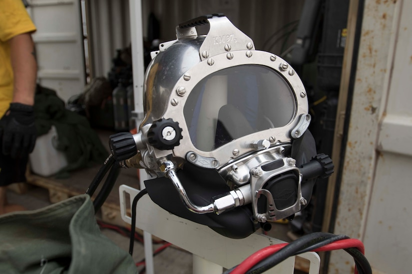 A diver's helmet is staged ready for the Soldier to wear while participating in the 511th Engineer Dive Detachment's annual training event 'shallow brown' at Kuwait Naval Base, Kuwait, July 19, 2019. The detachment is deployed to Kuwait in support of Operation Spartan Shield for U.S. Army Central. This training ensures the readiness of Soldiers within the ranks through equipment checks and qualifications.
