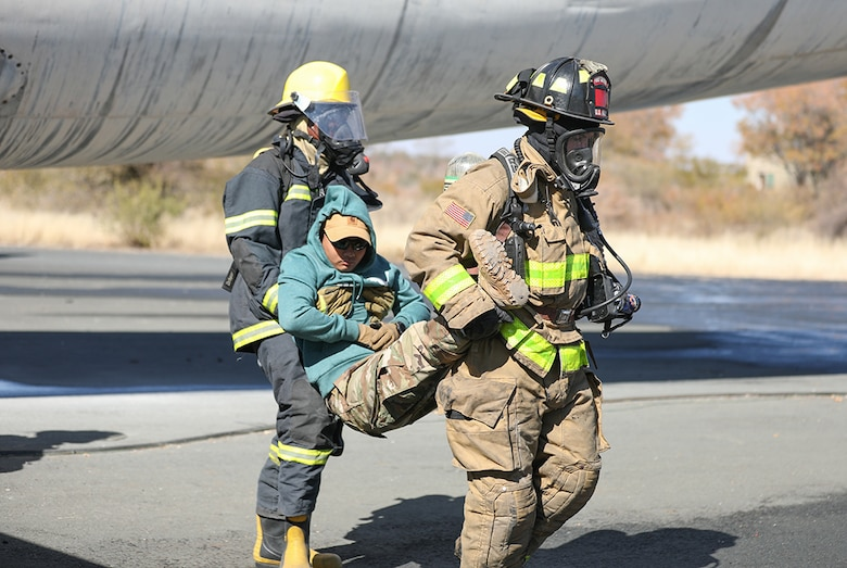 Firefighters with the Botswana Defense Force and the North Carolina National Guard work together to put out a fire and rescue victims from an airplane during a training exercise at Thebephatshwa Air Base in Botswana on July 17, 2019. The exercise was part of a two-day culminating event after more than 170 Army and Air Guard members.