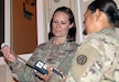 Capt. Jessica Myers, 3d Medical Command Deployment Support - Forward,  conducts an air quality assessment with Sgt. 1st Class Nichaya Srisark, Area Support Group - Qatar, at Camp As Sayliyah, Qatar, July 19, 2019.