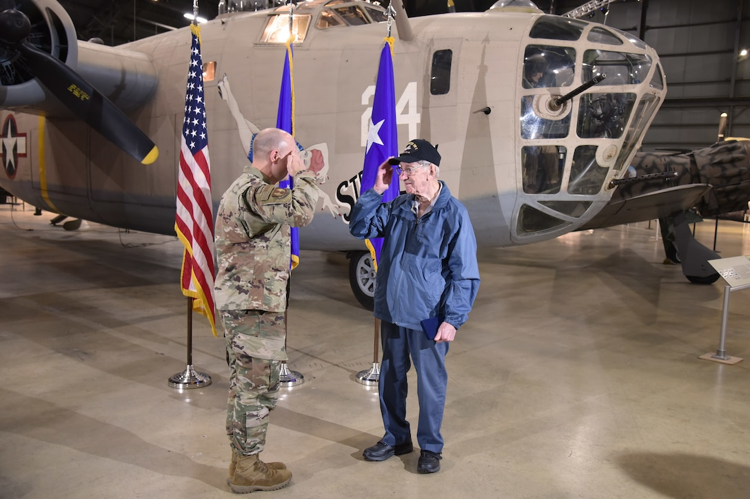 Maj. Gen. Carl Schaefer, Air Force Materiel Command deputy commander, renders a salute to 93-year-old World War II veteran 1st Lt. Joseph Kollenberg after a ceremony at the National Museum of the United States Air Force, July 24. Schaefer presented Kollenberg with the  Distinguished Flying Cross, the Air Medal with three Oak Leaf Clusters, and the European, African, and Middle Eastern campaign service medals to replace those misplaced in the 70 years since the veteran left active duty service. (Air Force photo/Ken LaRock)