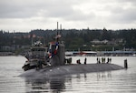 Sailors assigned to the fast-attack submarine USS Seawolf (SSN 21) return home to Naval Base Kitsap-Bremerton, following a six-month deployment. Seawolf is the first of the Navy's three Seawolf-class submarines, designed to be faster and quieter than its Los Angeles-class counterpart.