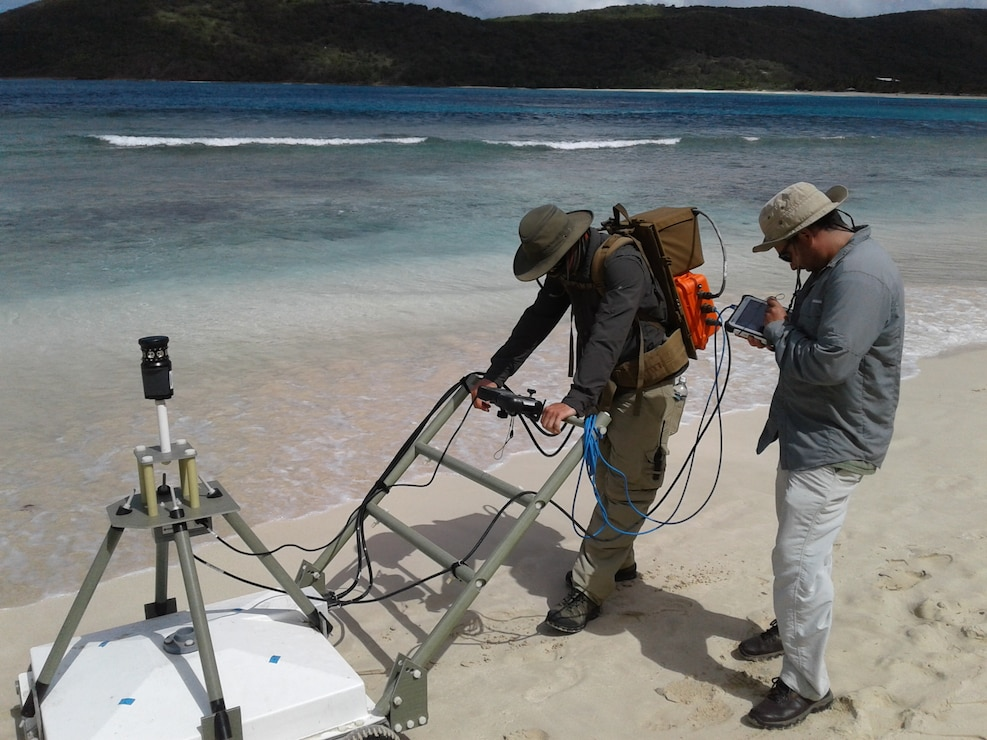 Workers use advanced geophysical classification to identify unexploded ordnances as part of the Time Critical Removal Action on Culebra Island in Puerto Rico. Advanced geophysical classification uses the natural properties of a buried metal to determine if the object is a target of interest. It will reduce the overall time and cost of remediation activities within the Formerly Used Defense Sites program.