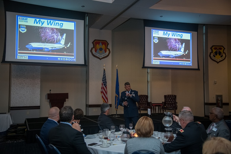 Col. Glenn Collins, commander, 932nd Airlift Wing shares information about the 932nd Airlift Wing mission and the Air Force Reserve Citizen Airmen that execute it daily with guests for the Employer Support of the Guard and Reserve award banquet, July 19, 2019, Scott Event Center, Scott Air Force Base, Illinois. (U.S. Air Force photo by Christopher Parr)