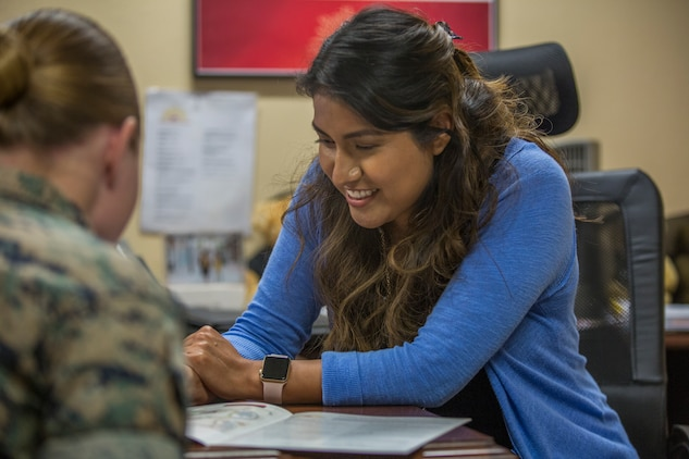 Estela Marin, an Arizona Western College representative for military members aboard Marine Corps Air Station (MCAS) Yuma, Ariz., gives assistance to a Marine at the MCAS Yuma Education Center, July 8, 2019. (U.S. Marine Corps photo by Cpl. Sabrina Candiaflores)