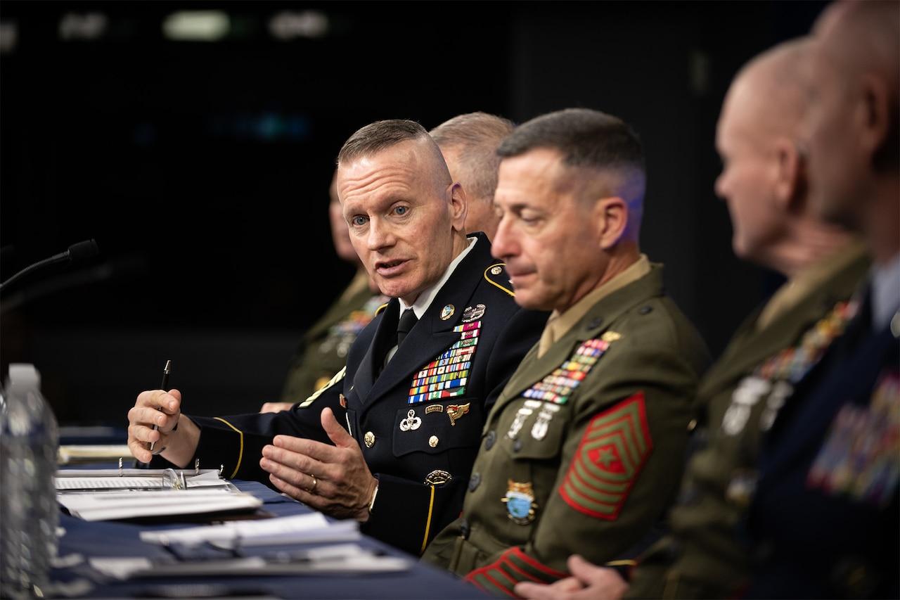 Sergeant major speaks to reporters alongside other senior enlisted leaders.